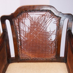 Caned chair before